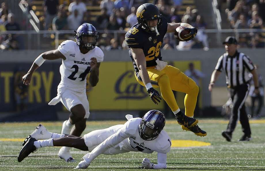 California running back Patrick Laird (28) jumps over Weber State safety Trey Hoskins during the second half of an NCAA college football game in Berkeley, Calif., Saturday, Sept. 9, 2017. (AP Photo/Jeff Chiu) Photo: Jeff Chiu, Associated Press
