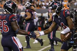 Houston Texans quarterback Deshaun Watson (4) celebrates with running back Lamar Miller (26) after Watson ran the ball 49-yards into the end zone for a touchdown during the second quarter of an NFL football game at Paul Brown Stadium on Thursday, Sept. 14, 2017, in Cincinnati. ( Brett Coomer / Houston Chronicle )