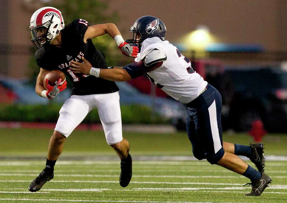Porter wide receiver Tayler Baker (13) tries to get past Katy Tompkins linebacker Ryan Cillessen (32) during the first quarter of a non-district high school game against Katy Tompkins at Texan Drive Stadium, Thursday, in New Caney. Photo: Jason Fochtman, Staff Photographer / © 2017 Houston Chronicle