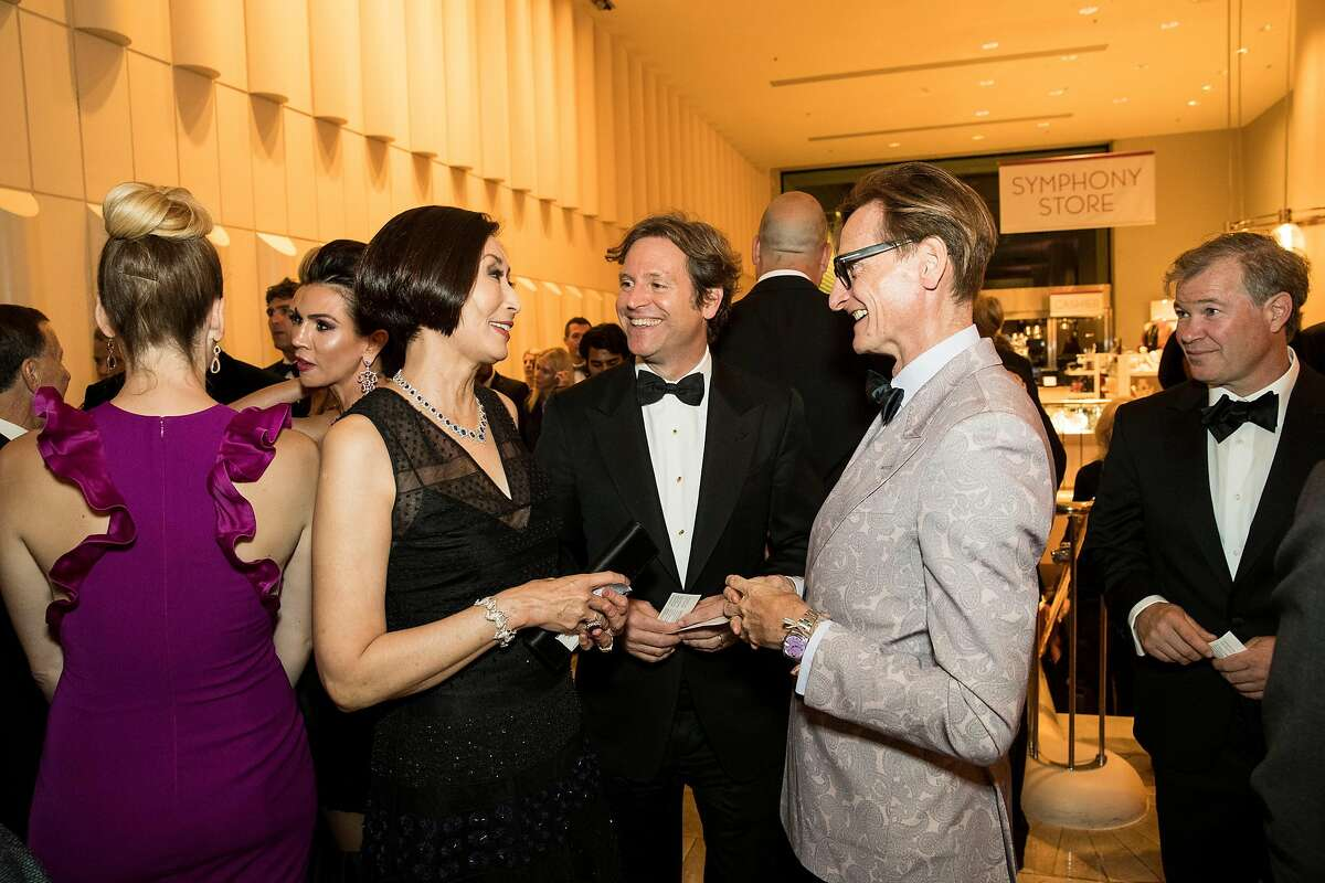 Yurie Pascarella, Trevor Traina and Hamish Bowles (center from left to right) chat with one other during the San Francisco Symphony Opening Night Gala at Davies Symphony Hall in San Francisco, Calif., on Thursday, September 14, 2017.