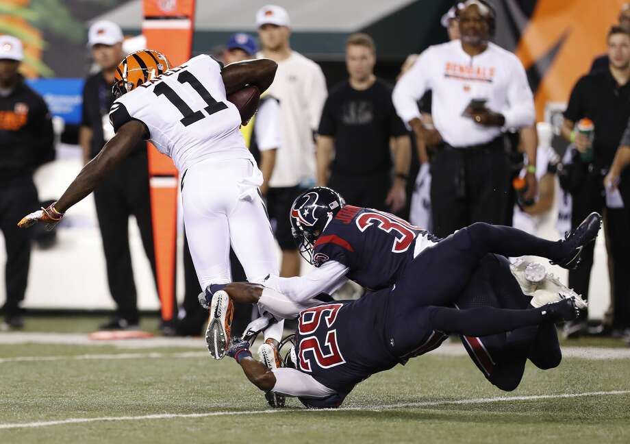 Houston Texans free safety Andre Hal (29) and cornerback Kevin Johnson (30) both try to stop Cincinnati Bengals wide receiver Brandon LaFell (11) during the third quarter of an NFL football game at Paul Brown Stadium on Thursday, Sept. 14, 2017, in Cincinnati. ( Brett Coomer / Houston Chronicle ) Photo: Brett Coomer/Houston Chronicle