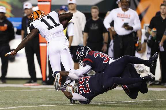 Houston Texans free safety Andre Hal (29) and cornerback Kevin Johnson (30) both try to stop Cincinnati Bengals wide receiver Brandon LaFell (11) during the third quarter of an NFL football game at Paul Brown Stadium on Thursday, Sept. 14, 2017, in Cincinnati. ( Brett Coomer / Houston Chronicle )