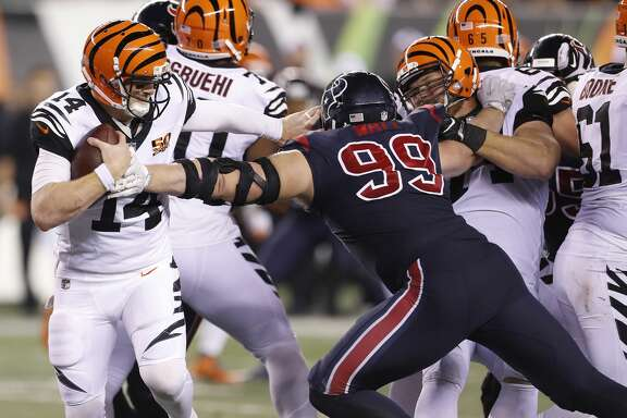 Houston Texans defensive end J.J. Watt (99) pressures Cincinnati Bengals quarterback Andy Dalton (14) who threw an incompete pass on thrid down during the foiurth quarter of an NFL football game at Paul Brown Stadium on Thursday, Sept. 14, 2017, in Cincinnati. ( Brett Coomer / Houston Chronicle )