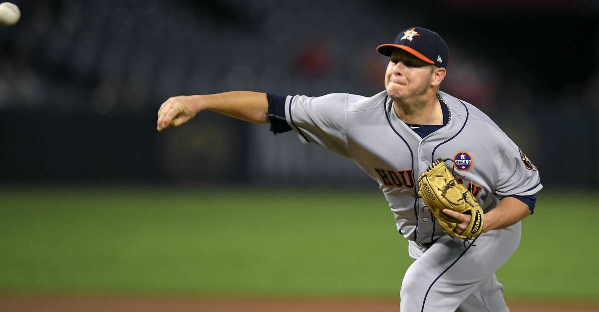 Houston Astros starting pitcher Brad Peacock throws to a Los Angeles Angels batter during the first inning of a baseball game Thursday, Sept. 14, 2017, in Anaheim, Calif. (AP Photo/Mark J. Terrill)