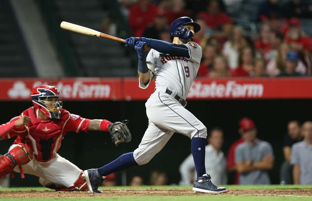 ANAHEIM, CA - SEPTEMBER 14: Marwin Gonzalez #9 of the Houston Astros hits a two-run double in the eighth inning against the Los Angeles Angels of Anaheim on September 14, 2017 at Angel Stadium of Anaheim in Anaheim, California. (Photo by Stephen Dunn/Getty Images)