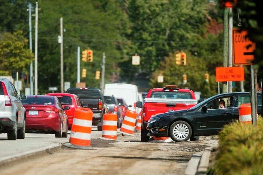 Traffic is backed up while construction is underway on M-20 near Main Street on Thursday in Midland. (Katy Kildee/kkildee@mdn.net)
