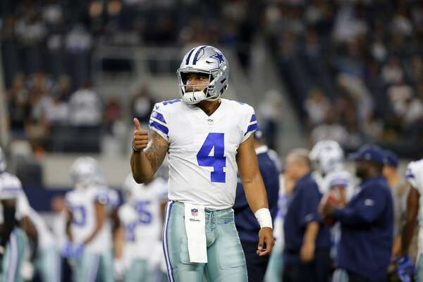 Dallas Cowboys quarterback Dak Prescott (4) gives a thumbs up as he walks to the sideline during a preseason NFL football game against the Oakland Raiders on Saturday, Aug. 26, 2017, in Arlington, Texas. (AP Photo/Sarah Warnock)