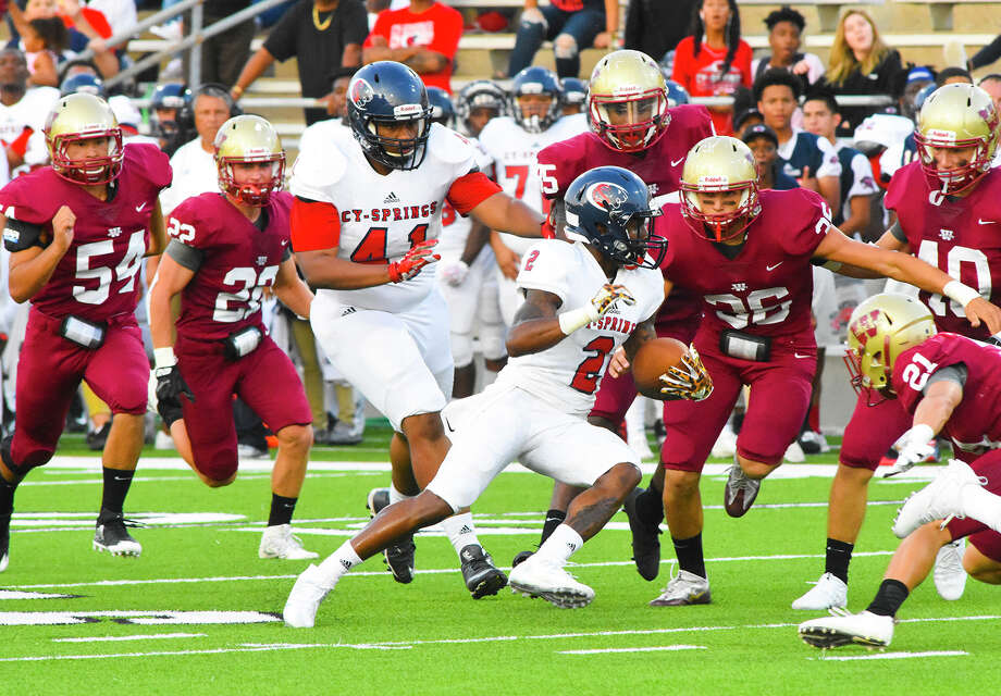 Cy Springs' Wing-T offense soared Thursday night at Ken Pridgeon Stadium, as Jah'marae Shepherd (2) racked up 127 all-purpose yards and two touchdowns and the Panthers defeated the Wildcats 27-9. Thursday marked the first time in 10 meetings that Cy Springs managed to edge Cy Woods. Photo: Tony Gaines / HCN