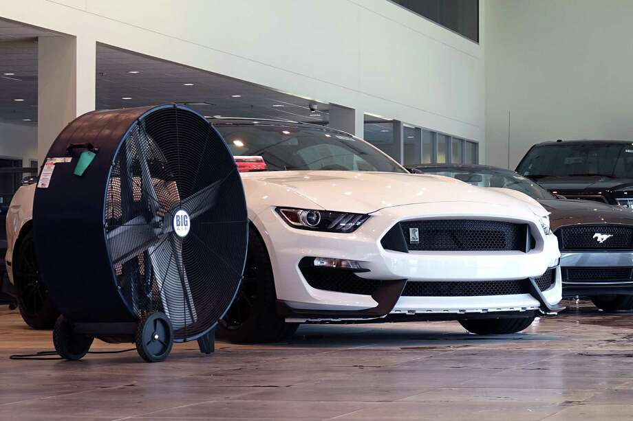 This $60,740 Ford Mustang Shelby GT350 was just one of dozens of new cars and trucks that had to be totaled after a car dealership was flooded in the wake of Hurricane Harvey. Photo: Jeff Yip