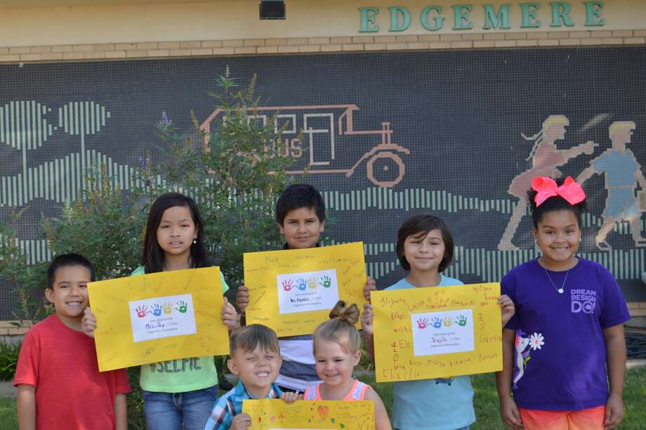 Following Hurricane Harvey, Edgemere Elementary did a project called Kids Helping Kids, with each student bringing a $1 donation to help a school in Humble damaged by the storm. To promote the charitable effort, each classroom make a poster, and students donating to the effort got to sign the poster and write well-wishes. The posters along with the $675 collected were sent to the school. Displaying posters are Aerin Morton (front left), Chloe Lovelady, Ivan Borgas (back left), Tina Phan, Izaiah Sanchez, Kelley Martinez and Janae Douglas.