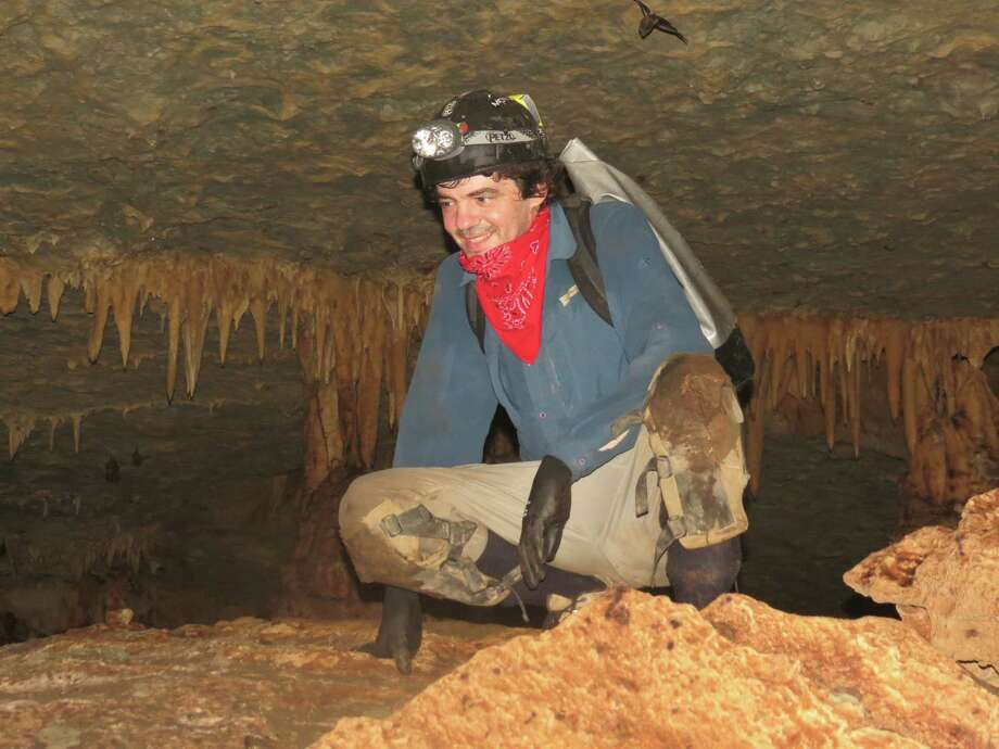 Mathias Vuille,  a professor of atmospheric and environmental sciences, explores a cave in Brazil to collect stalagmites that can be studied for clues to past climate.