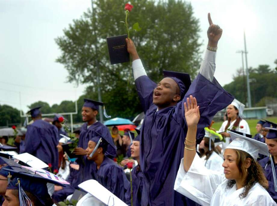 Othniel Jean cheers for classmates as they are awarded their diplomas during the Ansonia High School graduation ceremony Tuesday, June 22, 2010 at Jarvis Field. Photo: Lindsay Niegelberg / Connecticut Post