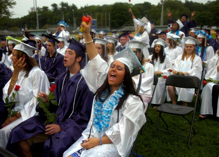 Ciana Hosking blows an air horn as she cheers for classmates being awarded their diplomas during the Ansonia High School graduation ceremony Tuesday, June 22, 2010 at Jarvis Field. Photo: Lindsay Niegelberg / Connecticut Post