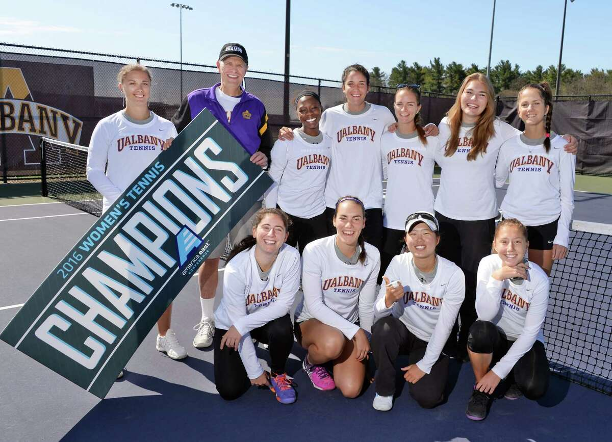 """Assistant coach Petra Ferancova, left, and head coach Gordon Graham pose with members of the University at Albany tennis team during their """"fan appreciation"""" celebration after qualifying for the NCAA Tournament Saturday April 30, 2016 in Albany, NY. (John Carl D'Annibale / Times Union)"""