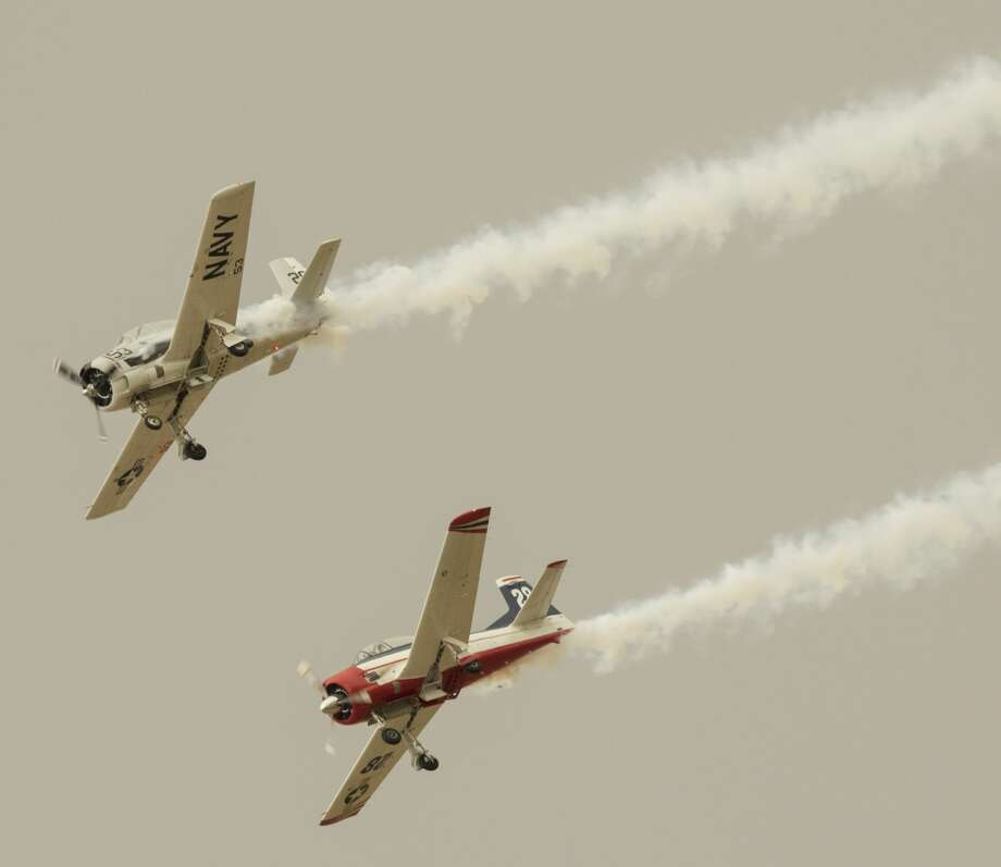 Two T-28's, part of the Flying Horseman display,  make a pass as vintage and modern aircraft take to the skies 9/15/17 morning for a practice run Air Sho. Tim Fischer/Reporter-Telegram Photo: Tim Fischer/Midland Reporter-Telegram