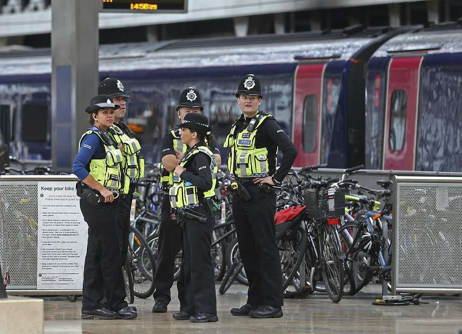 London officers patrol Paddington train station after a bombing at nearby Parsons Green subway station. Photo: Andrew Matthews, Associated Press