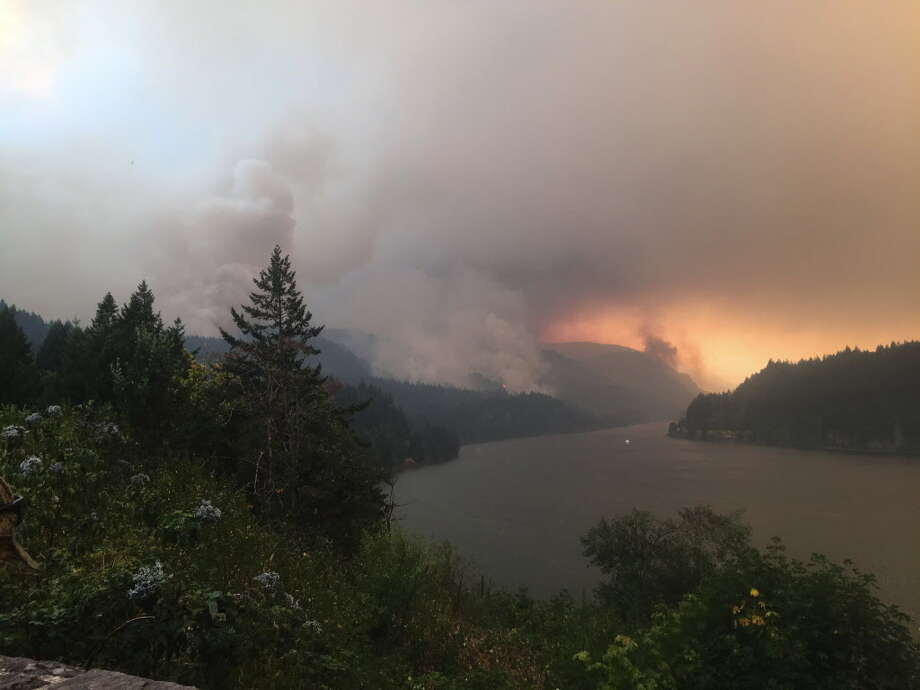 As winds kick up, the Eagle Creek fire races west down the Oregon side of the Columbia River Gorge on September 4, 2017, in Cascade Locks, Oregon. Ron Saikowski said the recent fires in Oregon and Washington State have impacted grape production on the West Coast. Photo: Hal Bernton, MBR / Seattle Times