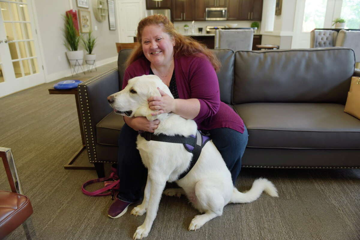 Tara Coons and her dog Felicity in the clubhouse at Van Allen Apartments on Thursday, Aug. 31, 2017, in Rensselaer, N.Y. (Paul Buckowski / Times Union)