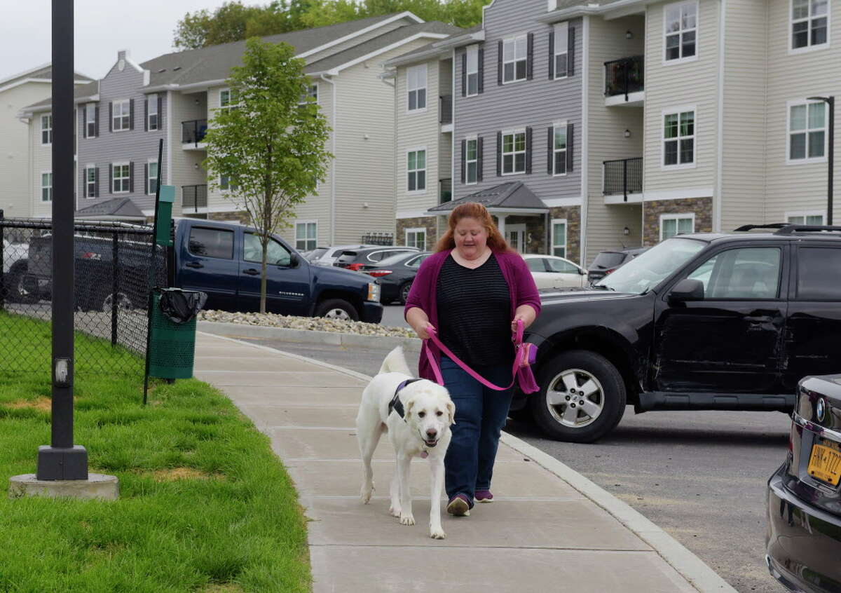 Click through for a slideshow of rentals that accept pets. Tara Coons and her dog Felicity walk through the complex at Van Allen Apartments on Thursday, Aug. 31, 2017, in Rensselaer, N.Y. (Paul Buckowski / Times Union)