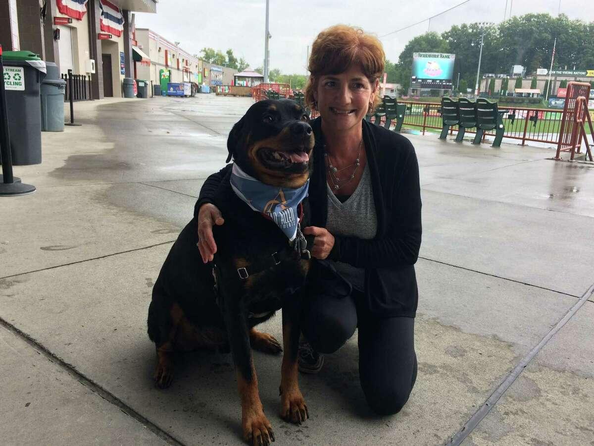 Tami Harrington and her dog Blaze at the Joseph L. Bruno Stadium Sept. 6, 2017.