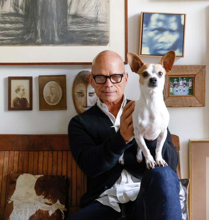Kevin Sessums and one of his dogs, Oakley, is seen in their home on Monday, Sept. 11, 2017 in San Francisco, Calif.