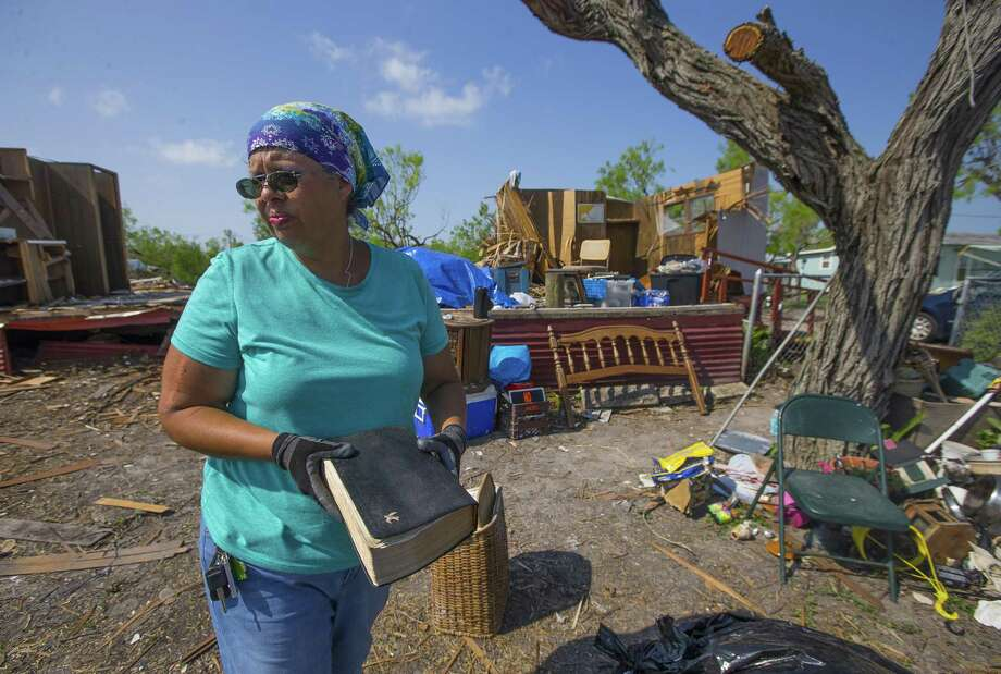 In this Thursday, Sept. 14, 2017 photo, Barbara De Luna holds a bible she recovered from her destroyed home in Bayside, Texas. Bayside took a direct hit from Hurricane Harvey on Aug. 25. (Mark Mulligan/Houston Chronicle via AP) Photo: Mark Mulligan, MBO / Associated Press / 2017 Mark Mulligan / Houston Chronicle