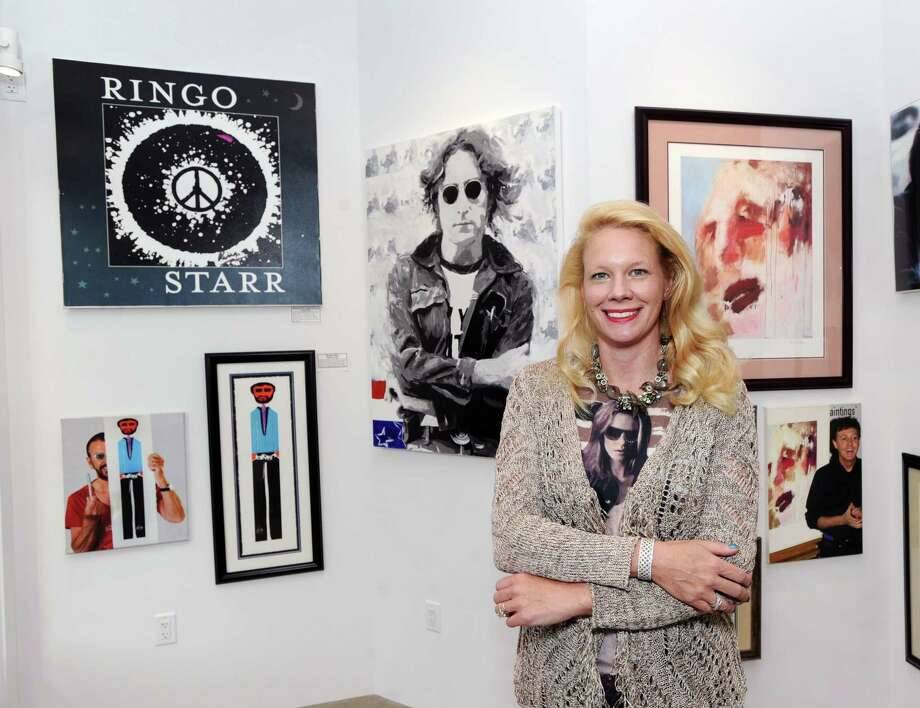 Tiffany Benincasa owner of the C. Parker Art Gallery inside its new Greenwich location at 409 Greenwich Avenue, Greenwich, Conn., Thursday, Sept. 14, 2017. The gallery formerly located on East Putnam Avenue in Greenwich is celebrating its move and grand re-opening with an exhibit featuring hand-signed artwork from John Lennon, Paul McCartney, George Harrison and Ringo Starr as well as works of the Beatles including pieces done by Andy Warhol. Photo: Bob Luckey Jr. / Hearst Connecticut Media / Greenwich Time