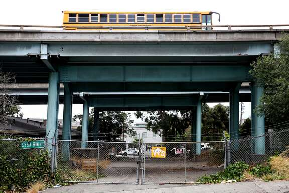 The lot under the freeway at 325 San Bruno Ave., between 16th and 17th Streets, is seen on Wednesday, Sept. 13, 2017, in San Francisco, Calif. A piece of state legislation, if signed by the governor, would allow S.F. to lease spaces beneath freeways currently owned by Caltrans. The city wants to turn these lots into open spaces and parks.