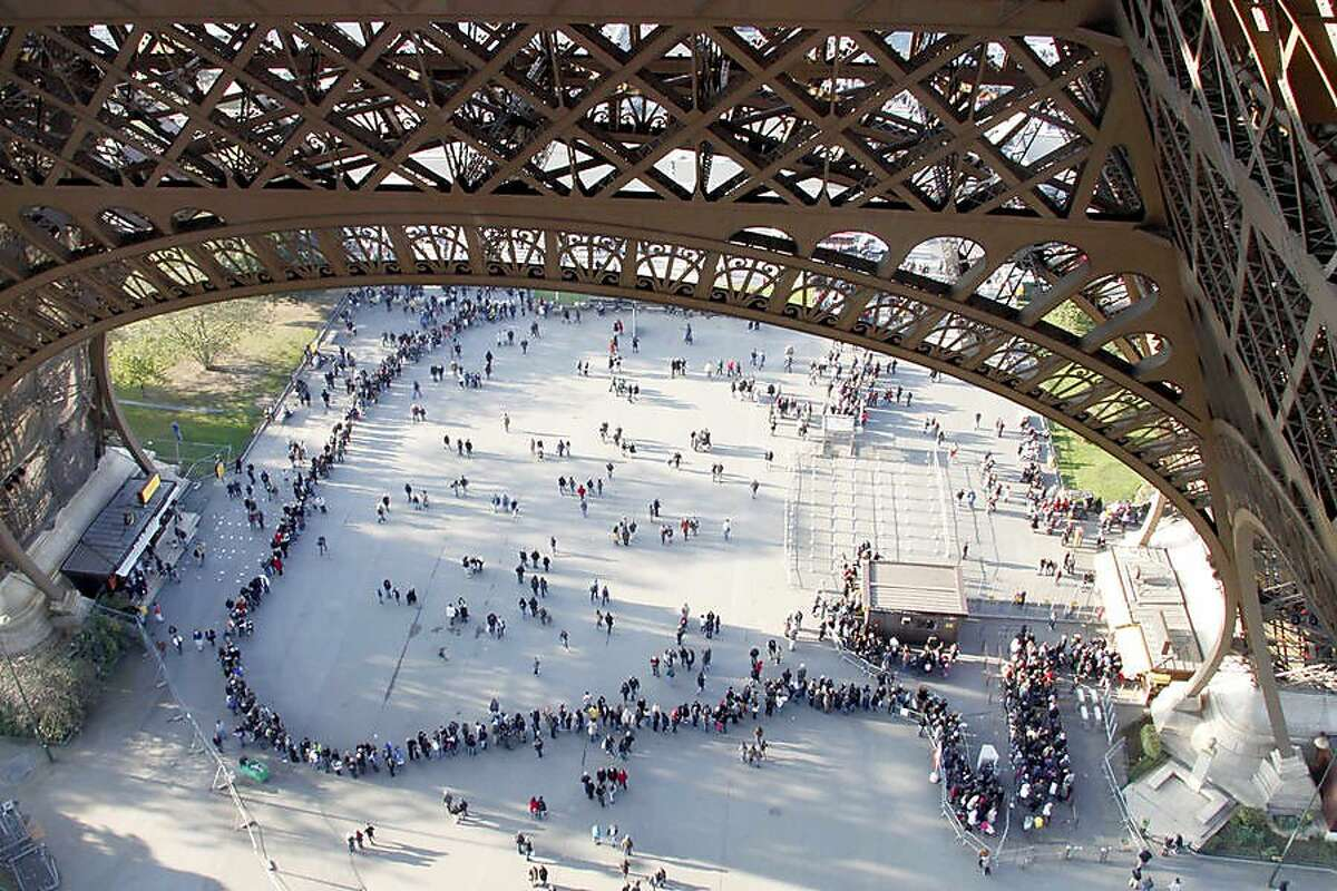 By booking ahead online, smart travelers can head right up the Eiffel Tower, high above the poor planners waiting in the ticket line.