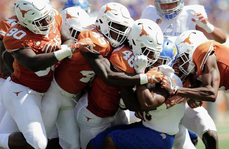 AUSTIN, TX - SEPTEMBER 09:  Tyler Nevens #23 of the San Jose State Spartans is tackled by Malik Jefferson #46 and DeShon Elliott #4 of the Texas Longhorns in the second quarter at Darrell K Royal-Texas Memorial Stadium on September 9, 2017 in Austin, Texas.  (Photo by Tim Warner/Getty Images) *** BESTPIX *** Photo: Tim Warner, Stringer / 2017 Getty Images