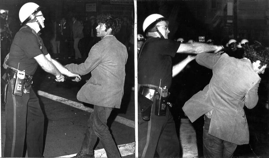 Police move a demonstrator who confronted an officer away from the Oakland Induction Center on Oct. 17, 1967.