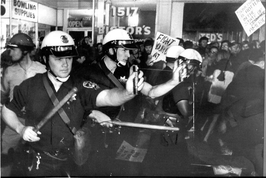 Police use Mace to move war protesters blocking access to the Oakland Induction Center on Oct. 17, 1967.