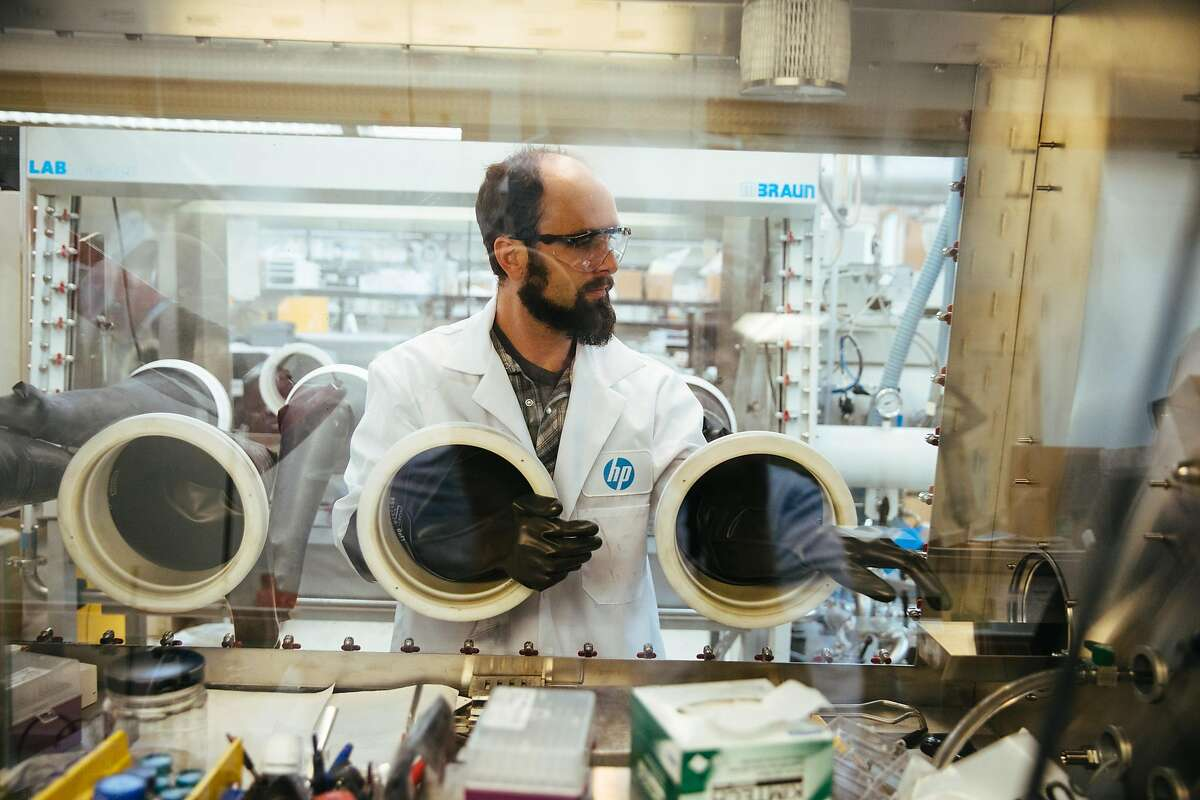 Senior research scientist, Kris Erickson, demonstrates the MBraun 8 glove inert environment glovebox at the HP Labs in Palo Alto, Calif. Thursday, September 7, 2017.