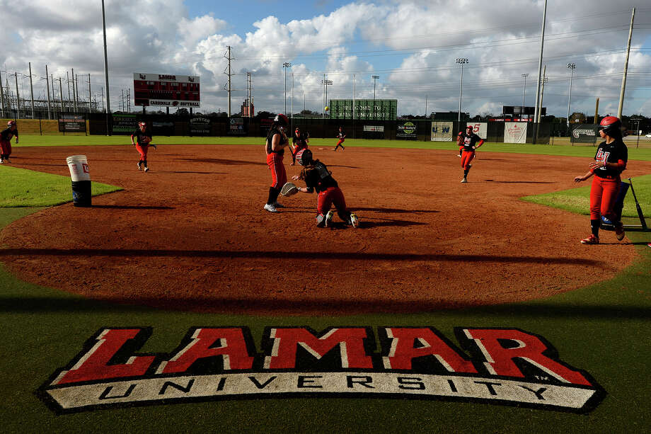 Lamar softball players practice base running and field play during their first practice of the season on Friday afternoon. The team will play an intrasquad scrimmage Sunday at 1:30 p.m. at the school's softball complex. Last year, the team played in the conference championship, their best year since the program restarted in 2013.  Photo taken Friday 1/13/17 Ryan Pelham/The Enterprise Photo: Ryan Pelham / ©2017 The Beaumont Enterprise/Ryan Pelham