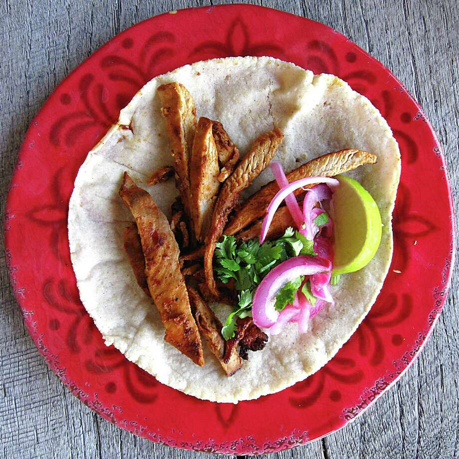 Chicken adobado taco on a handmade corn tortilla from El Taco Tote. Photo: Mike Sutter /San Antonio Express-News