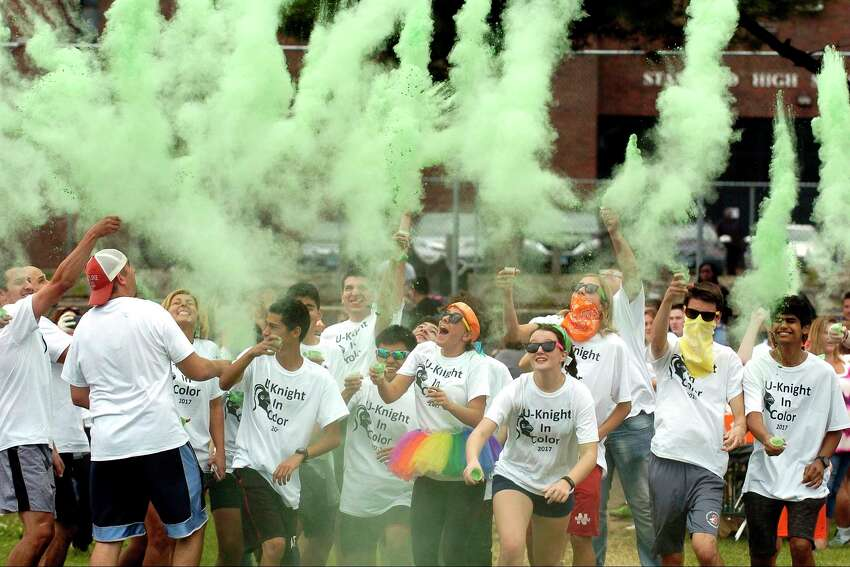 Students, teachers and administrators toss chalk into the air as they start the first annual U-Knight color run/walk at Stamford High School on Friday, Sept. 15, 2017 in Stamford, Connecticut. The event help bring the high school community together with 175 participating to raise over $5000 dollars to help fund classroom projects, an After Prom Party sponsored by the PTO and after school programs not funded by the school district.