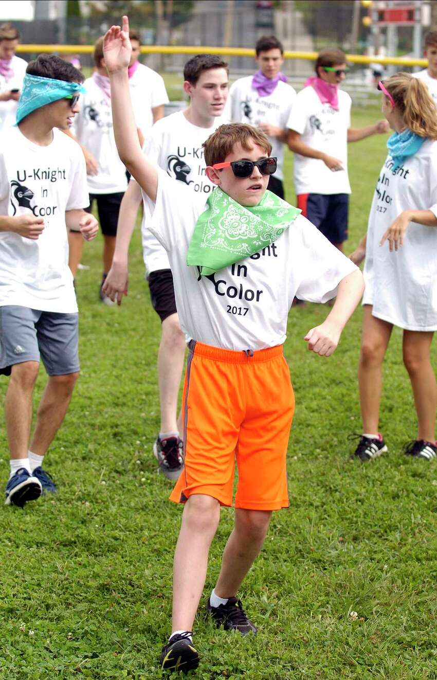 Ninth-grader Ryan O'shea shows his spirit as he prepares to participate in the first annual U-Knight color run/walk at Stamford High School on Friday, Sept. 15, 2017 in Stamford, Connecticut. The event help bring the high school community together with 175 students, teachers and administrators participating to raise over $5000 dollars to help fund classroom projects, an After Prom Party sponsored by the PTO and after school programs not funded by the school district.