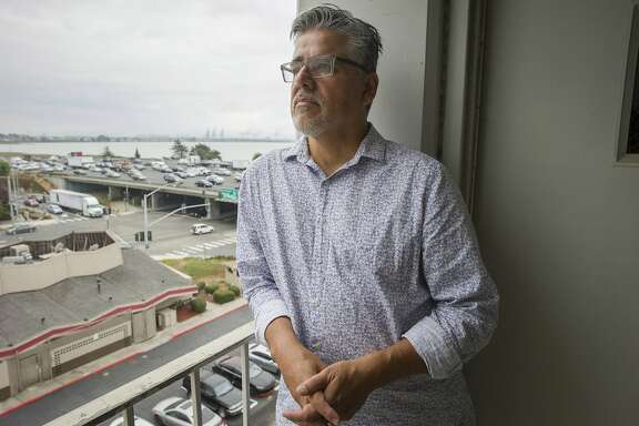 Former San Francisco supervisor John Avalos stands for a portrait on Thursday, Sept. 7, 2017, in Emeryville, Calif. Avalos, who now works as the coordinator for the National Union of Healthcare Workers, tried calling 911 from the Bay Bridge last week after spotting a man walking in traffic carrying what looked like a flail. He tried calling 911 three times and kept getting a busy signal.