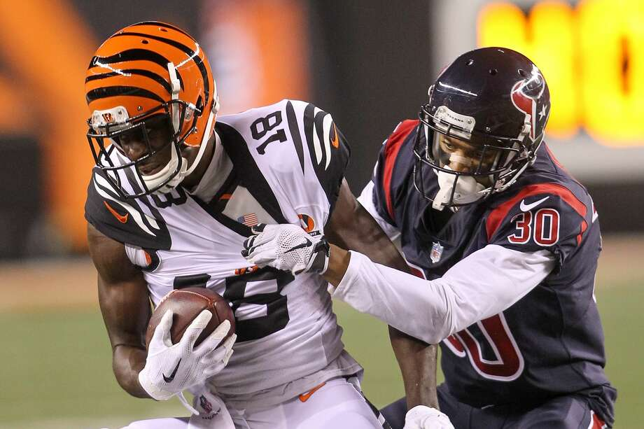 CINCINNATI, OH - SEPTEMBER 14:  A.J. Green #18 of the Cincinnati Bengals is tackled by Kevin Johnson #30 of the Houston Texans during the first half at Paul Brown Stadium on September 14, 2017 in Cincinnati, Ohio.  (Photo by John Grieshop/Getty Images) Photo: John Grieshop/Getty Images