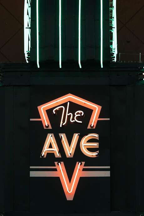 The Avenue Theatre on San Bruno Avenue in the Portola neighborhood proudly displays its radiant new neon sign. Photo: Mason Trinca, Special To The Chronicle