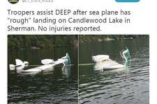 """Connecticut State Police tweeted two photos of a seaplane that had a """"hard landing"""" Candlewood Lake near Chicken Rock island in Sherman on Friday."""