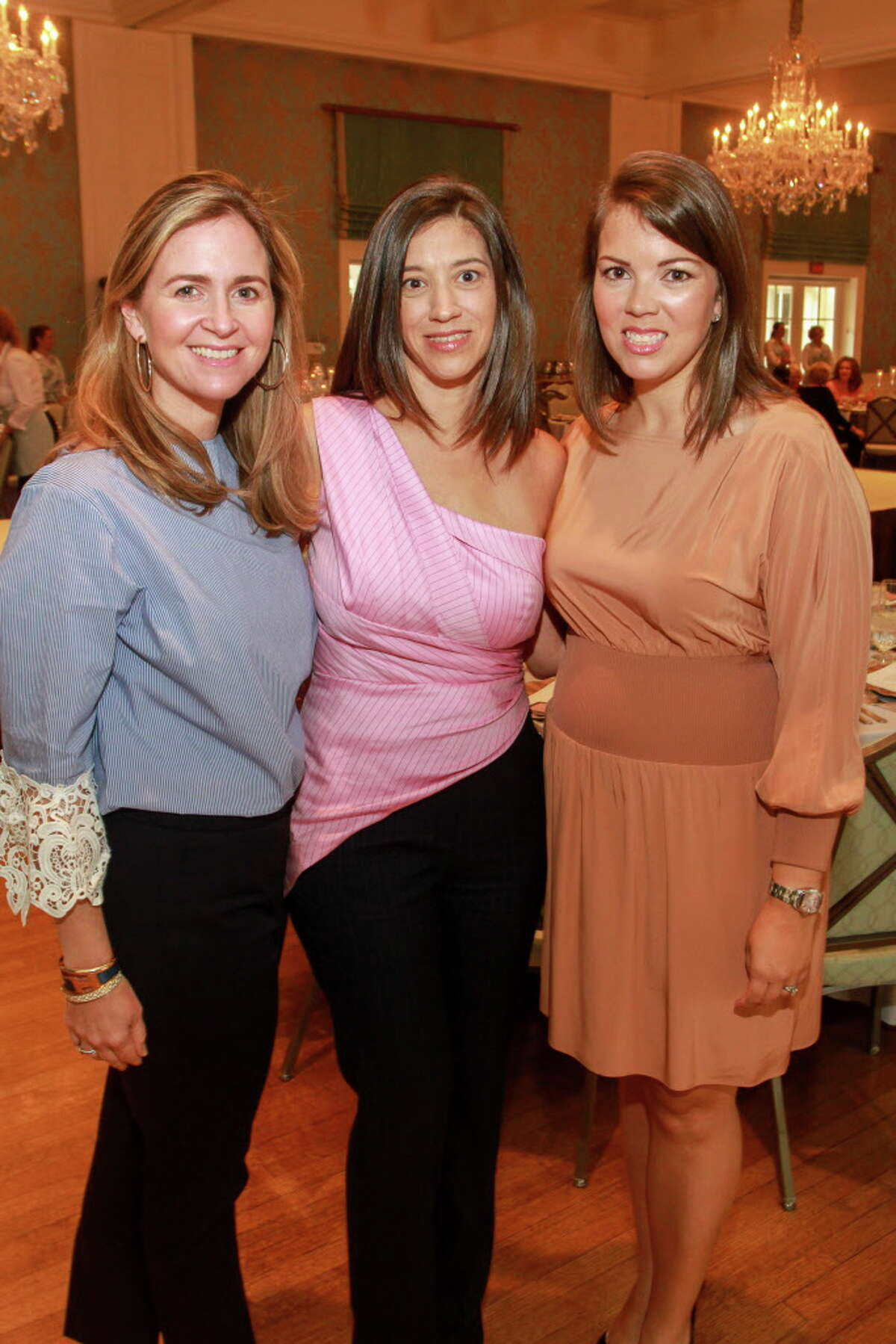 Macari Potter, from left, Sarah Snyder and Mary Lee Wilkens at the Beauty in Motion luncheon at the Junior League of Houston. (For the Chronicle/Gary Fountain, September 15, 2017)