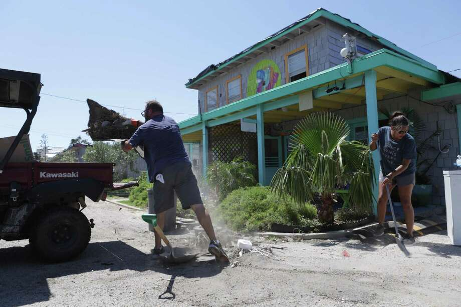 Lisa McClellan, right, General Manager at the Laughing Horse Lodge in Port Aransas, Texas, and longtime visitor Jeff Gregory of Fort Worth, clean up the popular vacation spot on Sept. 9. The lodge, built in the late '40s, was heavily damaged in Hurricane Harvey. It is inspiring how many volunteers have stepped up to lessen the load of Port Aransas cleanup, says a reader. Photo: Bob Owen /San Antonio Express-News / San Antonio Express-News