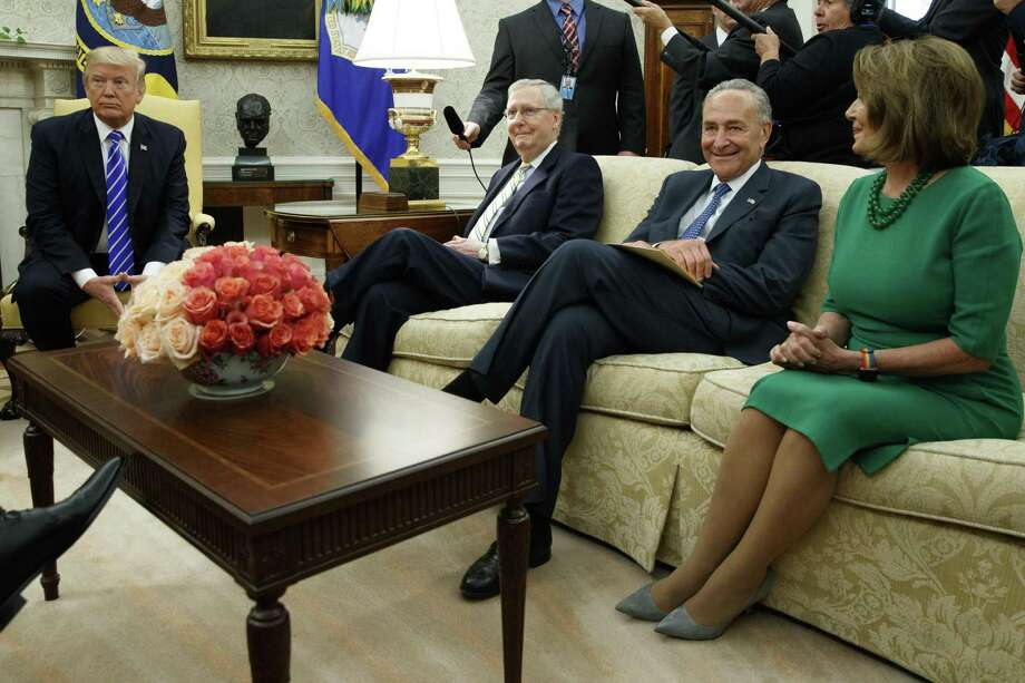 President Donald Trump pauses during a meeting with, from left, Senate Majority Leader Mitch McConnell, R-Ky., Senate Minority Leader Chuck Schumer, D-N.Y., House Minority Leader Nancy Pelosi, D-Calif., and other Congressional leaders in the Oval Office on Sept. 6. Trump's dalliance with Schumer will not end well. Photo: Evan Vucci /AP / Internal