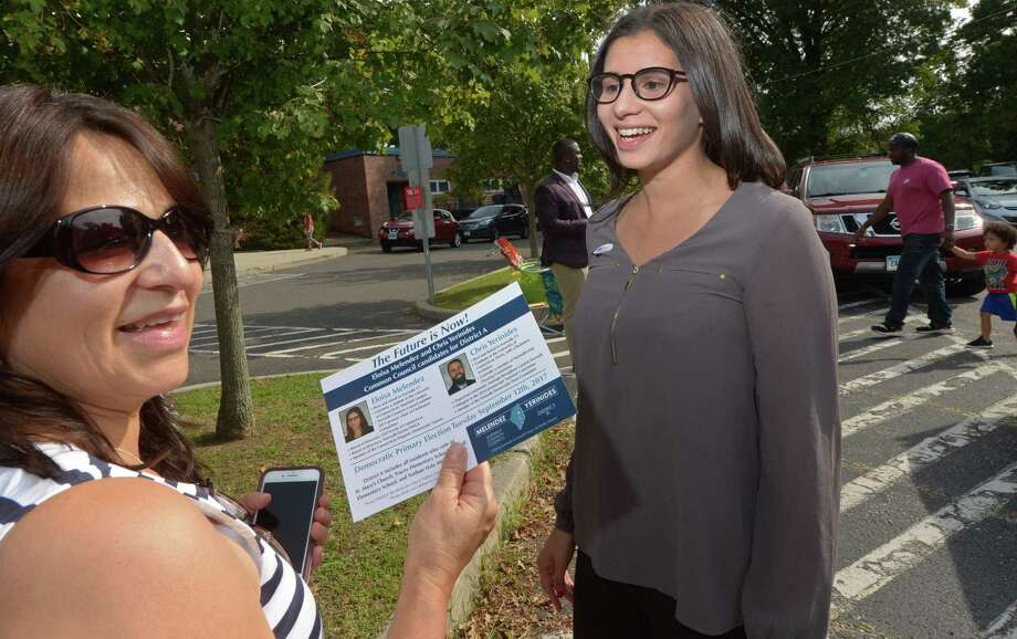 Candidate Eloisa Menendez, right, hands out literature to Doris Velez at Kendall Elementary School as District A Democrats head to the polls Tuesday, Sept. 12. Photo: Erik Trautmann / Hearst Connecticut Media / Norwalk Hour