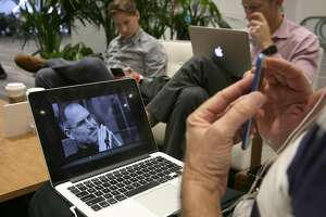 Drew Kimball (left), John Morris (middle right) from Braintrust Creative and Robert Hellestrae  (not seen in front with lap top) from Management Consulting catch a stream of the Apple conference while on break at the Mobile World Congress Americas at Moscone Center on Tuesday, September 12, 2017, in San Francisco, Calif.
