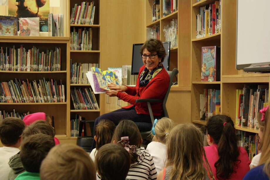 State Rep. Livvy Floren, R-Greenwich, reads to students on Read Across America Day. Photo: Contributed Photo / Greenwich Time Contributed