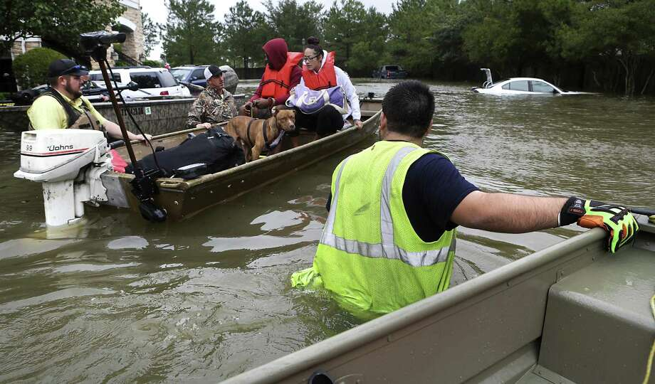 "T.J. Walsh, right, a volunteer rescue worker from San Antonio, assists in rescuing a family from the Kelliwood subdivision in Houston on Aug. 29. Many rescuers in Houston were working class Texas conservatives that Hillary Clinton decried as ""deplorables"" during her presidential campaign, says a reader. Photo: Bob Owen /San Antonio Express-News / ©2017 San Antonio Express-News"