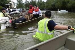 """T.J. Walsh, right, a volunteer rescue worker from San Antonio, assists in rescuing a family from the Kelliwood subdivision in Houston on Aug. 29. Many rescuers in Houston were working class Texas conservatives that Hillary Clinton decried as """"deplorables"""" during her presidential campaign, says a reader."""