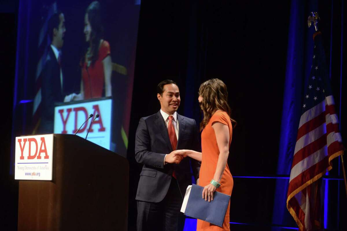 San Antonio Mayor Julian Castro is greeted by Monique Diaz Pfullman, president of the Bexar County Young Democrats, during the Young Democrats of America national convention at the Marriott Rivercenter on Saturday, August 10, 2013.